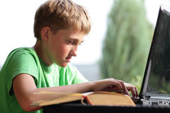 Boy on Computer. A child surfing the internet using a wireless connection outdoors Royalty Free Stock Photography