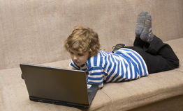 Boy with computer Royalty Free Stock Photography