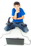Boy with computer and joystick Royalty Free Stock Images