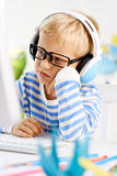 Boy at computer Royalty Free Stock Photography