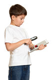 Boy with computer tablet found a bug, information security concept Stock Images