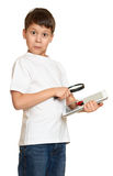 Boy with computer tablet found a bug, information security concept Royalty Free Stock Photography