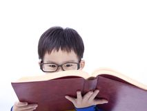 Boy Concentrate on studying. Asian boy Concentrate on studying with book Stock Photo