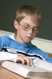 Boy concentrated with reading stock images