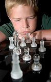 Boy concentrating on his next chess move