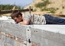 Boy on concrete building Stock Photos