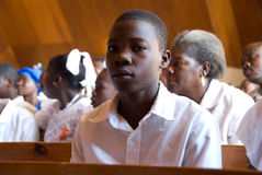 Boy at Confirmation. October 2, 2008 - A group of youth in Gonaives, Haiti, take part in a Catholic confirmation ceremony weeks after Hurricane Ike devastated Stock Image