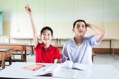 Boy confused with answer but another one hand raise up to answer the question