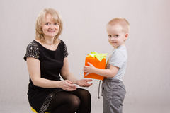 Boy congratulates mom happy birthday. Five children congratulates mother and gives gifts stock photos