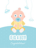 It is a boy. Congratulations. Vector flat illustration of greeting card with baby boy. Soft pastel colors.  Kid dressed in overalls sits on the floor Stock Images