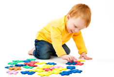 Boy connect puzzles Royalty Free Stock Image