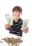 Boy considers money. In piggy bank Stock Photo