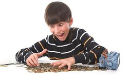 Boy considers money. In piggy bank Royalty Free Stock Photography