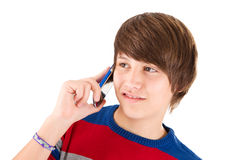 Boy constantly on phone. Boy constantly on the phone - isolated on white royalty free stock photography