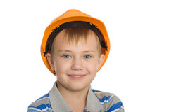 Boy in the construction helmet. Royalty Free Stock Photo
