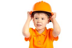 Boy in construction helmet Royalty Free Stock Image
