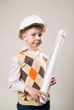 Boy in a construction helmet holding a drawing Stock Photo