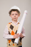 Boy in a construction helmet holding a drawing Royalty Free Stock Images