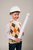 Boy in a construction helmet holding a drawing Royalty Free Stock Photography