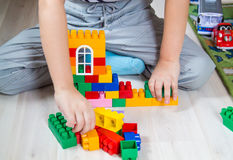 Boy and constructor. Boy sitting on the floor and plays in constructor stock images