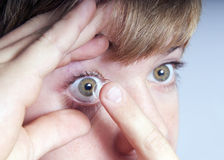 Boy with contact lens Stock Photography