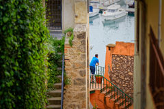 Boy contemplating the sea from an alley in Porto Ercole.  stock image