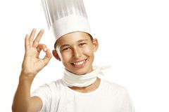Boy cook. Happy boy cook on white background make ok stock photography