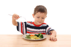 Boy and cooked vegetables Stock Photo