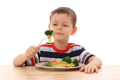 Boy and cooked vegetables Royalty Free Stock Photo