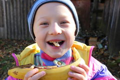 Boy and cookies in the teeth Royalty Free Stock Photography
