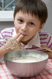 Boy cooking Stock Images