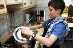 Boy cooking. Noodles for a vegetarian casserole Royalty Free Stock Photography