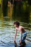 Boy cooling off in a lake Royalty Free Stock Photo