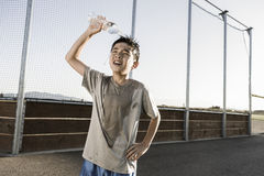 Boy cools off after practice. Royalty Free Stock Photo