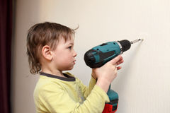 Boy with cordless screwdrivers Stock Image