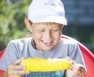Boy with corn Stock Image