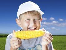 Boy with corn Stock Photos