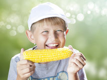 Boy with corn stock photo