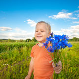 Boy with cornflowers Royalty Free Stock Photo