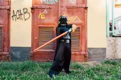 Boy in a costume of  Darth Vader with sword. Stock Photos