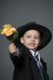 Boy in costume with flowers Stock Photography