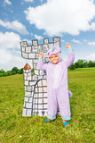 Boy in costume of monster stands near drawn tower Stock Photography