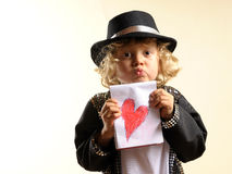 Boy in costume, sending a kiss and a heart Royalty Free Stock Image