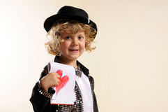 Boy in costume, showing a drawing of a heart Royalty Free Stock Images