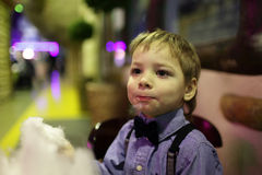 Boy with cotton candy Royalty Free Stock Image