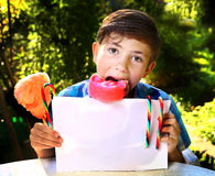 Boy with cotton candy and sheet of paper Royalty Free Stock Images