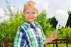Boy with cotton candy Royalty Free Stock Photo