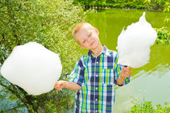 Boy with cotton candy Royalty Free Stock Images