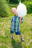 Boy with cotton candy Royalty Free Stock Photography