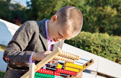 Boy counting abacus Stock Photography